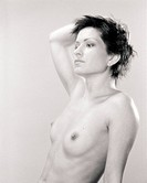 Beauty naked woman studio portrait. Scanned black and white film source