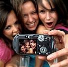 Young Women Taking Picture Together