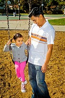 A Filipino-American father and his four-year-old daughter visit a playground in Cerritos, CA