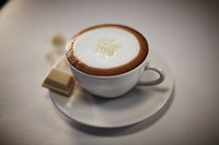Cup of vanilla caffe latte with whipped cream