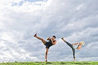 Couple kicking together outdoors
