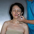Doctor Using Marker on Woman´s Face