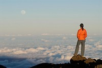 Woman standing on top of mountain