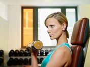 Blond Woman Lifting Weights