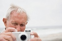 Senior Man Taking a Picture
