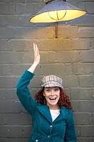 Woman Wearing Hat Under Street Light