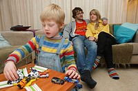 White family, boy playing with toys