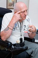 Male wheelchair user having a cup of tea,