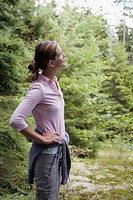 Woman standing in woods
