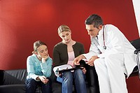 Doctor consulting with patients