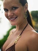 Young woman wearing brown and gold bikini