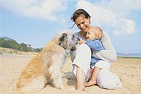 Mother and Young Son with Dog at Beach