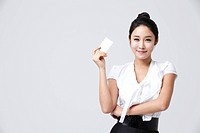 Businesswoman Holding A Credit Card