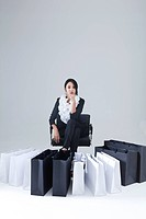 Woman Sitting In Front Of Shopping Bags