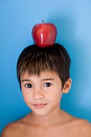 Little Boy with an Apple on His Head