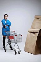 Woman Standing Among Paper Bag
