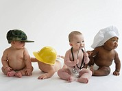 Babies in occupational hats sitting on floor together