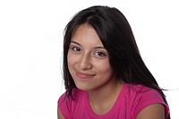 Studio portrait of Hispanic teenage girl smiling on white background