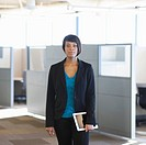 African American businesswoman holding digital tablet in office