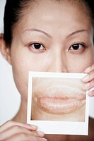 Woman Holding Close Up Photograph of Lips
