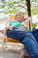 Pregnant woman sitting in an outdoor chair