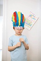 Boy wearing headdress
