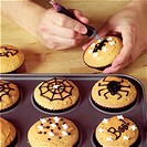 Making Halloween Cupcakes - decorating the cupcakes - step shot