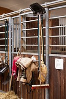 Tools for work in a stable hanging on the outside of a box