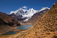 The lakes Laguna Jahuacocha and Laguna Solteracocha with the mountains Nevado Rondoy, Jirishanca, Nevado Yerupaja, Cordillera Huayhuash mountain range...