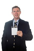 Businessman in a suit holding a blank conference pass on a lanyard