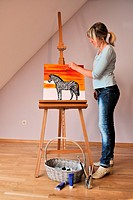woman paints a picture zebra