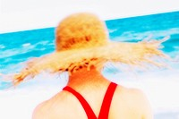 Woman at the Beach Wearing a Straw Hat
