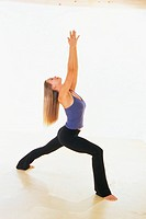 Woman Doing Sun Salutation Yoga Pose