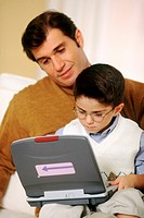 Father and son using an ELA laptop