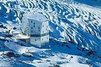 Aerial view of an alpine hut in the mountains, the New Monte Rosa_Hut with Grenzgletscher glacier in the background, Zermatt, Valais, Switzerland