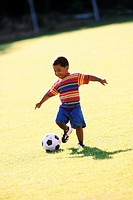 Kid with a soccer ball