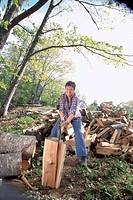 Woman chopping wood