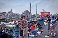 Anglers on Galata bridge at Golden Horn, Blue mosque in the background, Istanbul, Turkey, Europe