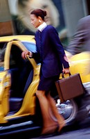 Businesswoman getting in a cab
