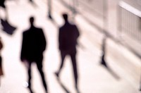 Silhouetted business pedestrians