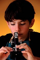 Student with a microscope