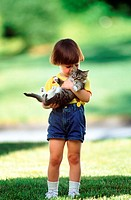 Child Hugging Kitten