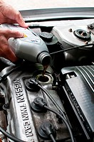 Topping up car engine oil