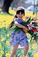 Girl carrying a bundle of wildflowers