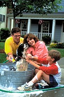Family giving the dog a bath