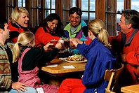 Friends having lunch in a ski lodge