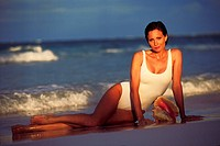 Woman lounging in the surf