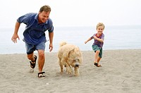 Running with their wet dog