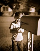 Excited Boy Opening Mailbox