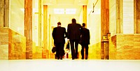 Businessmen Walking Down a Corridor